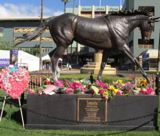 Flowers on Zenyatta's statue. Photo courtesy of Gloria Ubardelli.