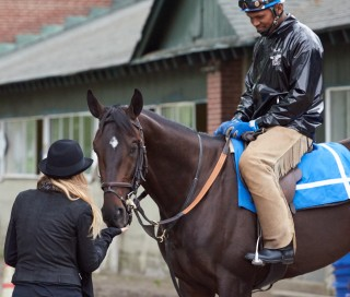 Coz gets a treat from Ann last year at Belmont. Photo by Kyle Acebo.