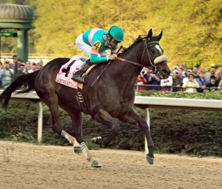 April 9, 2010, Zenyatta and jockey Mike Smith race down the stretch on the way to winning the $500,000 Apple Blossom Invitational horse race at Oaklawn Park in Hot Springs, Ark. (AP Photo/Danny Johnston)