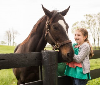 Tiana with Zenyatta. Photo by Krystal Mitchell/Ginger Snaps.